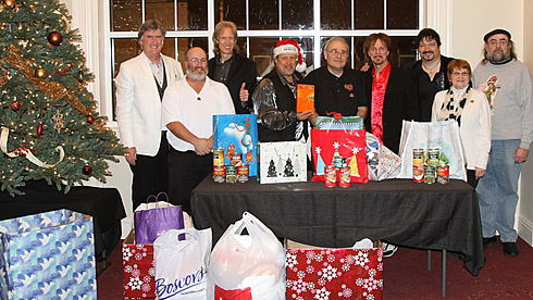 A Classic Rock Christmas and the staff of the Levoy Theater in Millville, NJ and some ofthe donations they collected,